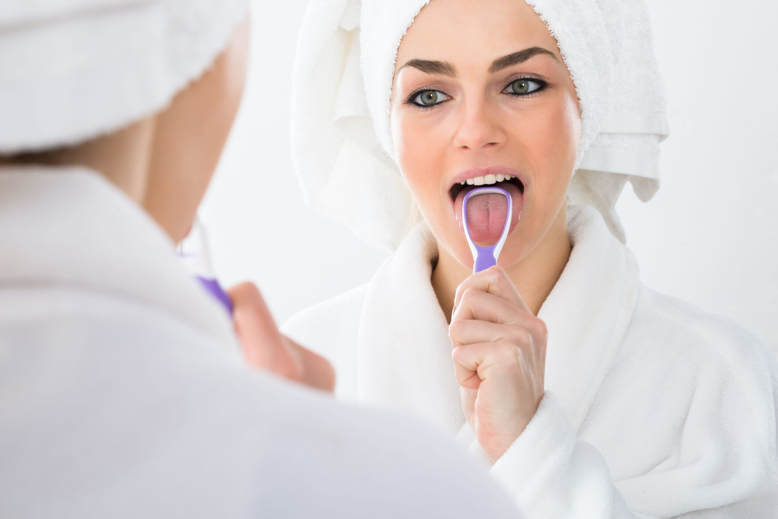 Dentist Sioux City | Should I Be Using a Tongue Scraper?
